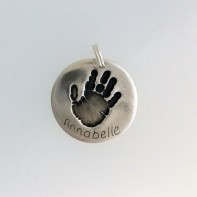 A Silver Handprint Circle Pendant by SilverEdge Designs, Southampton.